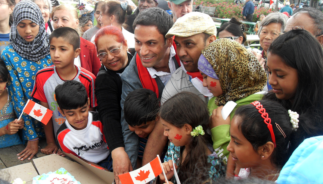 Gerry Sklavounos, Quebec politician Liberal Member of the National Assembly present himself cutting the Canada Day Cake with Monir Hossain, President NBCC and coordinator Parc-Ex Canada Day Celebration at our Parc-Ex Canada Day Celebration